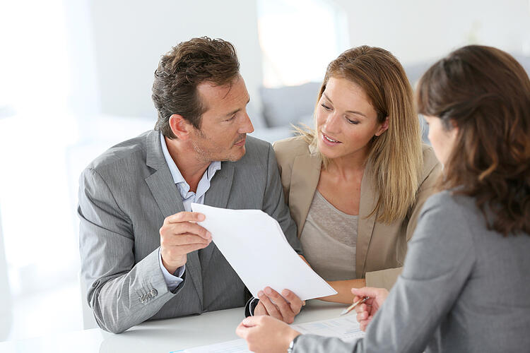 Couple meeting financial adviser for financing pre-approval